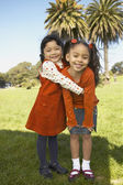 Portrait of young girls hugging — Stock Photo