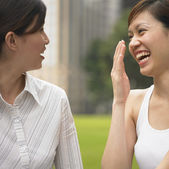 Two women laughing in park — Stock Photo