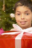 Hispanic boy with Christmas gift — Stock Photo