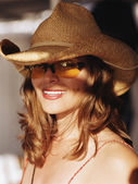 Young woman in hat and sunglasses — Stock Photo