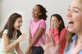Four girls laughing — Stock Photo