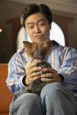 Man holding dog in lap — Stock Photo