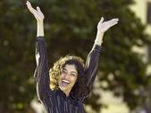 Businesswoman celebrating outdoors — Stock Photo