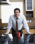 Hispanic businessman in kitchen — Stock Photo