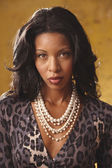 Portrait of African woman wearing leopard print blouse — Stock Photo
