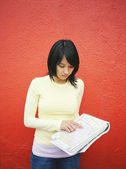 Young woman checking road map — Stock Photo
