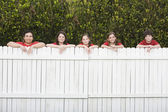 Mixed Race family leaning on fence — Foto Stock