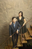 Portrait of couple on stairs — 图库照片