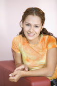 Portrait of teenage girl smiling — Stock Photo