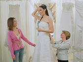 Young bride-to-be trying on her gown — Stok fotoğraf