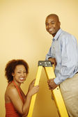 Portrait of couple with ladder — Stock Photo