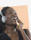 Young woman listening to headphones — Stock Photo