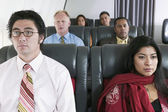 Group of passengers on airplane — Stock Photo