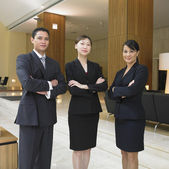 Businesspeople standing in lobby — Stock Photo