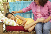 Hispanic mother and daughter on bench outdoors — Stock Photo