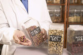 Male herbalist doctor with Chinese medicinal herbs — Stock Photo