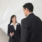 Businesspeople talking in hallway — Stock Photo