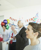 Group of coworkers at a retirement party — Stock Photo