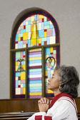 African American female Reverend praying — Stock Photo