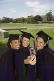 Female graduates taking self portrait — Stock Photo