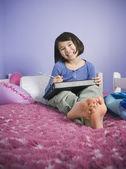Chica haciendo tarea — Foto de Stock