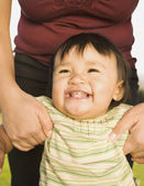 Close up of Pacific Islander baby smiling — Stock Photo