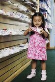 Young Hispanic girl at shoe store — Stock Photo