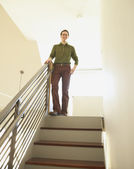 Businessman standing at the top of a staircase — Stock Photo
