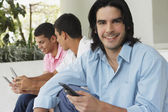 South American men using cell phones — Stock Photo