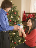 Man giving woman Christmas gift — Photo
