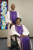 Senior African couple wearing church choir gowns — Stock Photo