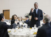 Businessman making a toast at lunch — Stock Photo