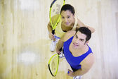 High angle view of man and woman with Squash rackets — Stock Photo