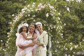 Hispanic bride with mother and young girl smiling — Stock Photo