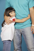 Young girl hugging torso of young man — Foto Stock