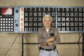 Man standing in front of bingo board — Stock Photo