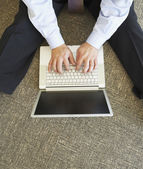 High angle view of businessman using laptop — Stock Photo