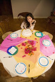 Hispanic girl sitting alone at birthday party — Stock Photo