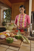 Woman cooking in kitchen — Stock Photo