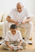 Indian father and son playing video games — Stock Photo