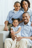 Portrait of African family on sofa — Stock Photo