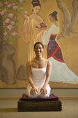 Woman doing yoga in spa room — Stock Photo