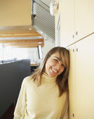 Businesswoman laughing in office space — Stock Photo