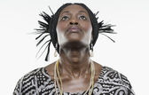 Woman in traditional African dress looking up — Stock Photo