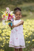 Portrait of girl with bouquet of flowers — Stock Photo