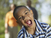 Young African boy with mouth wide open — Stock Photo