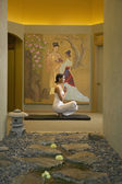 Woman doing yoga in spa room — Stock Photo