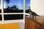 Toy dinosaurs on cabinet — Stock Photo