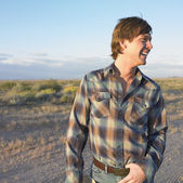 Profile of man laughing outdoors — Stock Photo