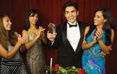 Young man accepting an award — Stock Photo